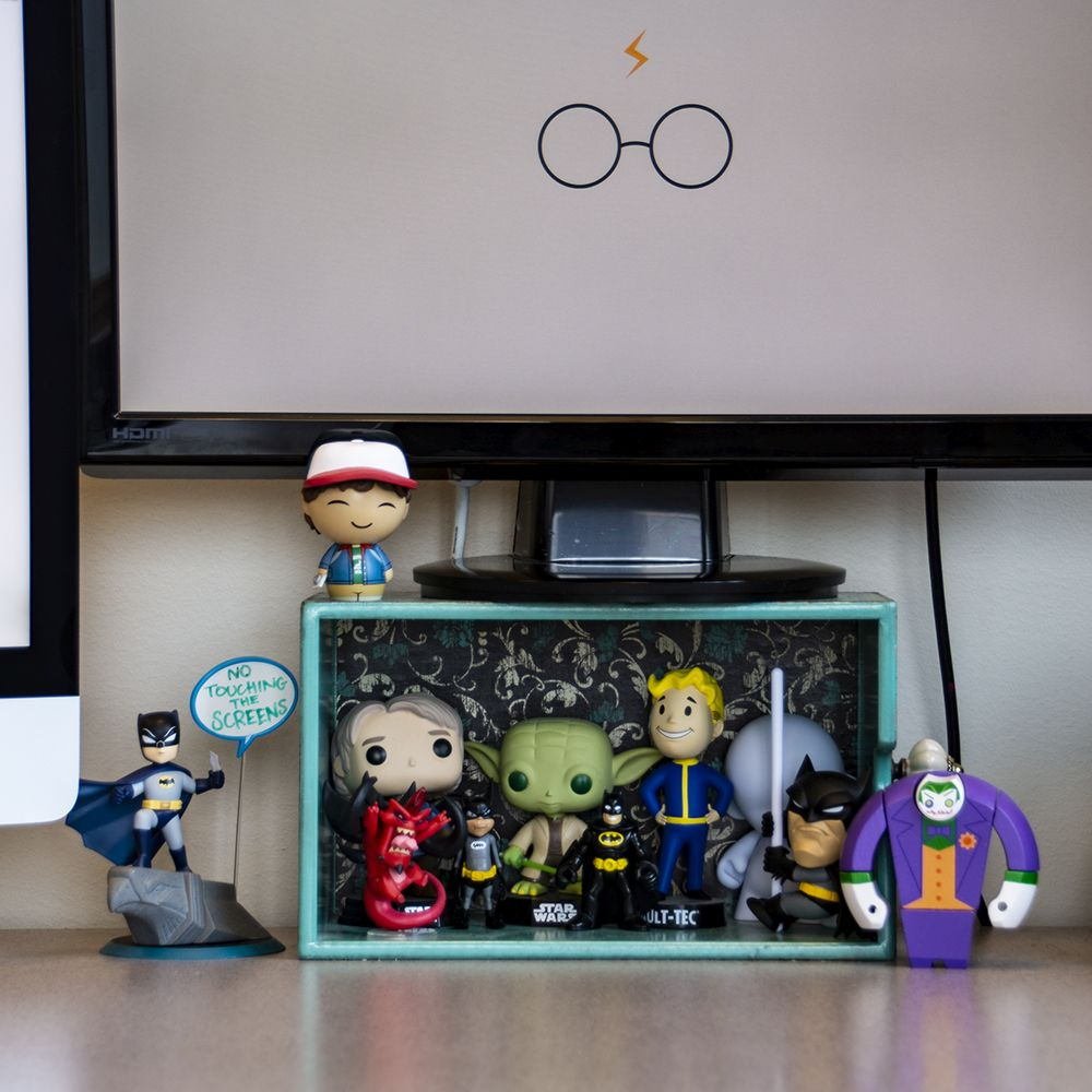Comic and game character models on a desk
